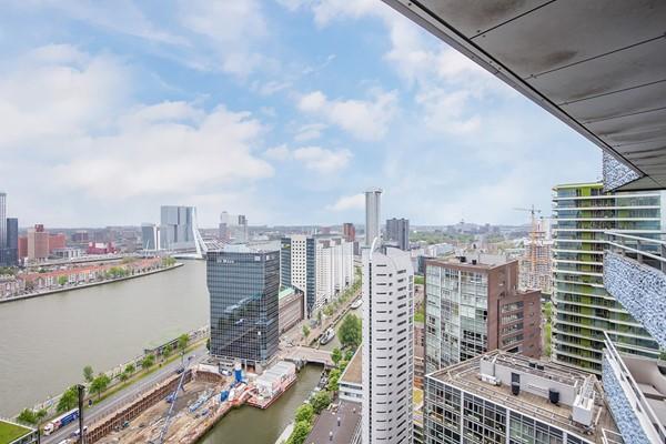 33e verdieping, uitzicht over de Maas, privé parkeerplaats